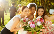 Shot of the bride and bridesmaids taking a selfie with a cellphone