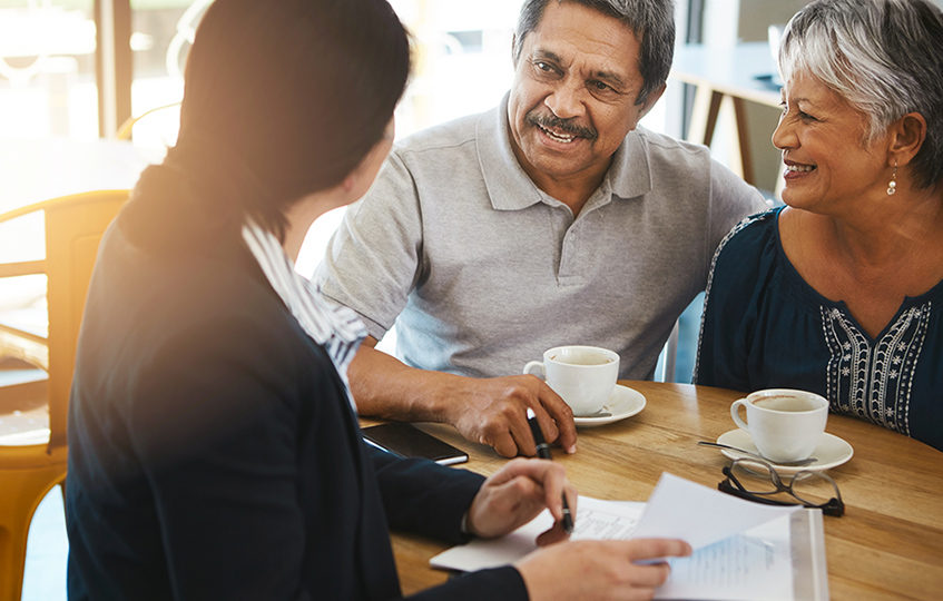 Senior couple meeting up with a financial advisor