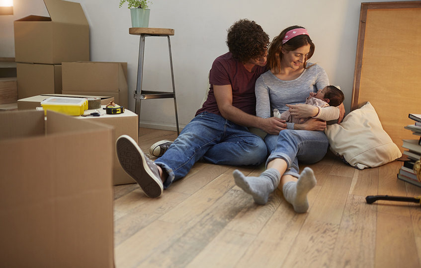 Millennial Parents moving to a new apartment with baby.