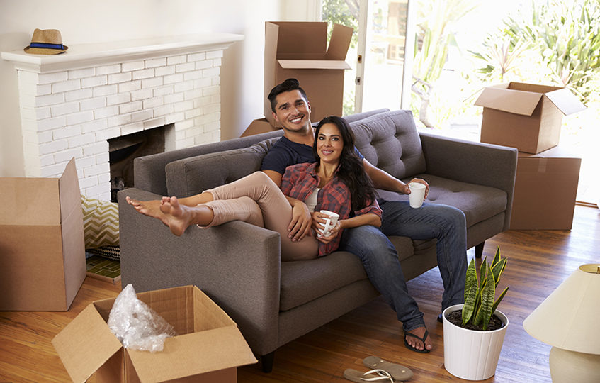 Couple sitting on couch in living room.