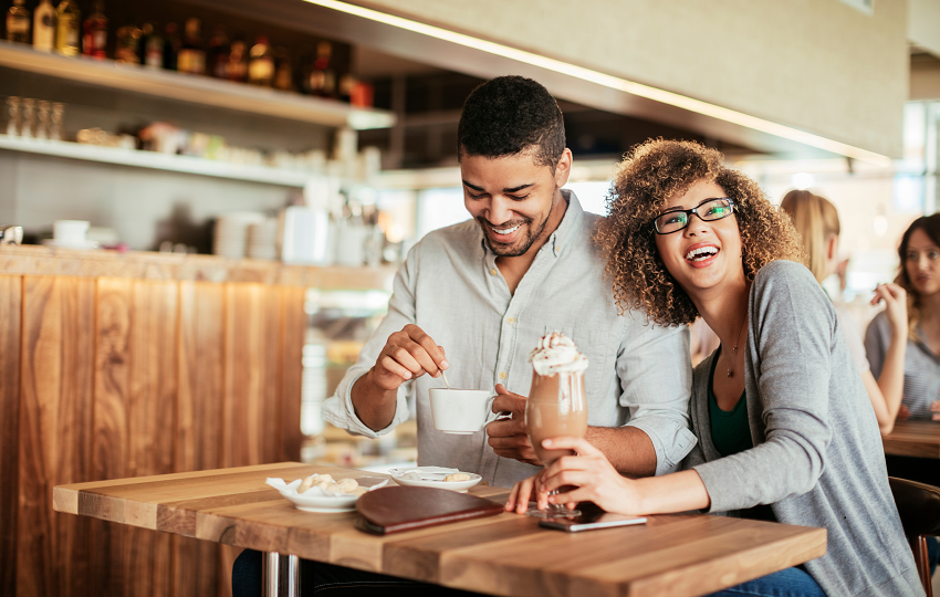 young couple enjoying drinks together at a coffee shop