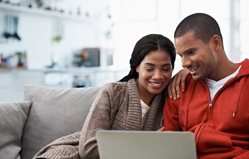 Couple looking at joint insurance policies together on their laptop