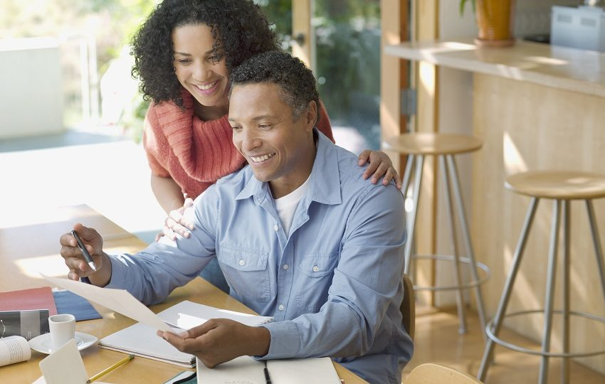 Couple planning budget together