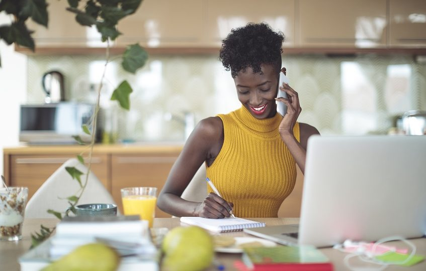 Young woman working at home, setting financial goals