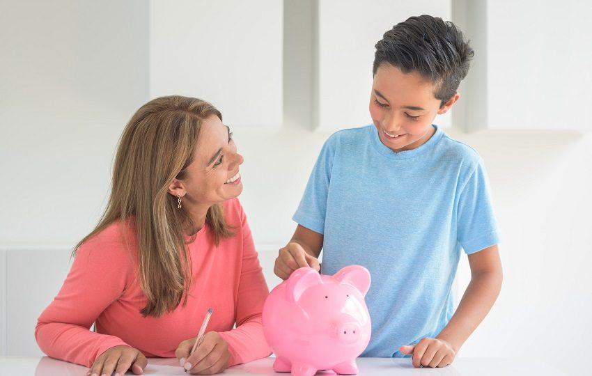 Mother saving for her boy's education in a piggybank