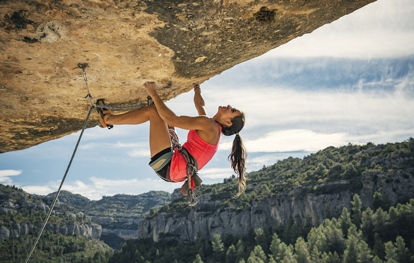 Young woman rock climbing